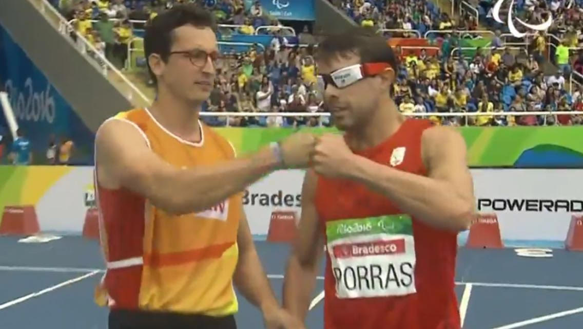 Image of Xavi and Enric fist bump before start 100m Rio 2016